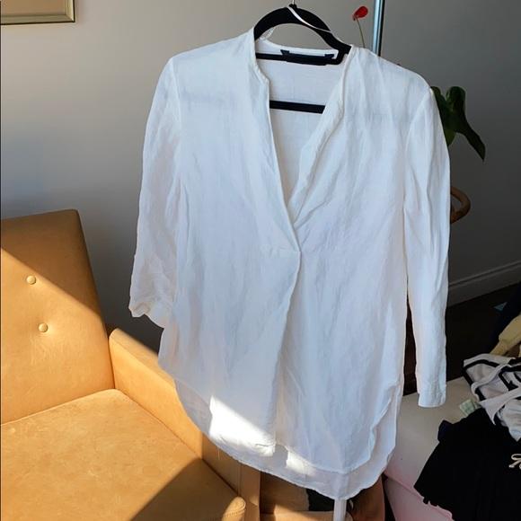 White flowy linen blouse